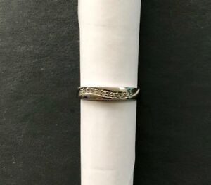 9 ct white gold eternity band ring set with 11 diamonds.hallmarked ,size N.