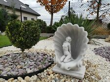 Aphrodite embedded in a shell garden ornament