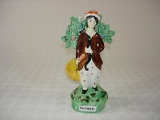 Pearlware Glazed figure of a Female Archer with Bocage -  Staffordshire c.1820