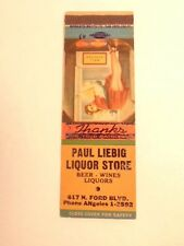 match book cover w/ pin-up style girl :ad for Paul Liebig Liquor Store