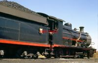 PHOTO  SOUTH AFRICAN RAILWAYS -  EX CLASS 1 AT NEW CLYDESDALE 9/72 A NUMBER OF S