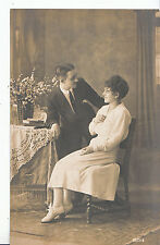 Romance Postcard - Young Lady Sitting Down With Your Man Leaning Beside  ZZ3526