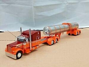 "Dcp Custom stretched orange/red PETERBILT 379 63"" w/Custom tank trailer 1/64"