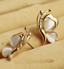 UTILITY butterfly white stone golden plated wing ear pierced earrings new.