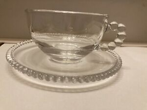 Glass set of 4 pretty cups and saucers for tea.  Bobbles around handle and edge.