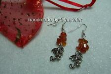 Mystical Dragon drop Earrings with Red Carnelian gemstone crystals in a gift bag