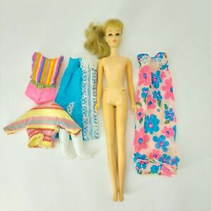 Vintage 1960s TNT Twist and Turn Blonde Francie Barbie Doll with tagged fashion