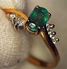 Anillo oro amarillo 18 cts con 6 Diamantes y Esmeralda natural