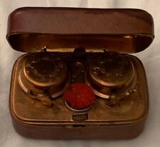 Antique trunk shape leather cased brass travelling inkwell with two wells with o