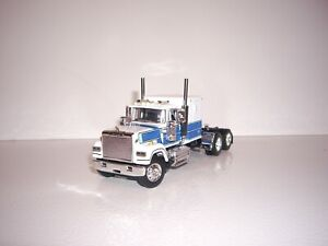 DCP FIRST GEAR 1/64 WHITE AND BLUE MACK SUPER-LINER WITH 60'' SLEEPER