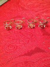 [4] two piece Las Vegas shot glasses and gold color metal holders