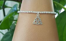 silver plated stretchy stacking bracelet with Celtic knot charm