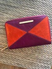 Trina Turk wallet orange purple with gold hardware