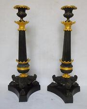 Paire de bougeoirs flambeaux tripodes Empire, bronze patiné et doré, époque XIXe