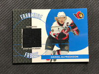 2003-04 TOPPS TRADED & ROOKIES DANIEL ALFREDSSON FRANCHISE FABRIC JERSEY #FF-DA