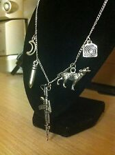 teen wolf themed silver charm necklace, wolf, bullet, rifle, moon, spiral