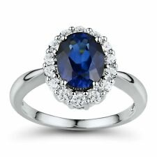 Created Blue & White Sapphire Halo Ring in Sterling Silver