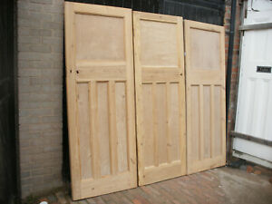 Reclaimed 1920s / 1930s 1 over 3 panel stripped pine doors.