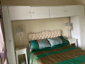 overbed storage and wardrobe unit