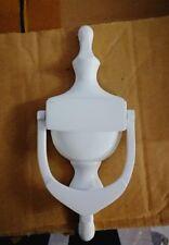 white urn door knocker