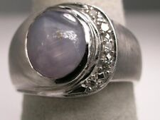 14kt White Solid Gold Ring with a Genuine Blue Star Sapphire and 5 round f