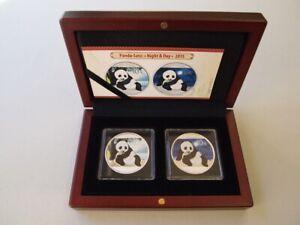 "Panda-Satz ""Night & Day"" 2015, 2 x 10 Yuan, je 1 Unze Silber, stgl., coloriert"