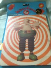 A Wallace and Gromit mouse mat in original packet.
