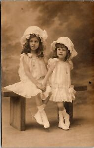 TWO YOUNG SISTERS : ADORABLE : IDENTICALLY DRESSED : RPPC