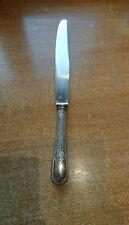 1 couteau de service de table en métal argenté  longueur : 31,5 cm