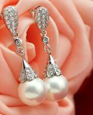 Stirling silver pearl drop earrings.