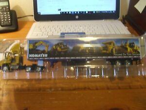 First Gear 69-0018 Komatsu International 8600 & 53' Demo Trailer, 1:64, BNIB
