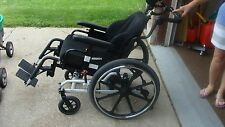wheel chair, adjustable foot rest, head rest, and reclining seat