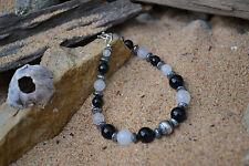 Handmade bracelet with Sterling Silver, Black Onyx & White Jade.