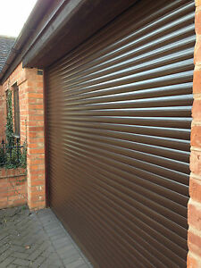 ELECTRIC GARAGE DOOR  9FT X 8FT NEW  INSULATED WITH 2 REMOTES  NUT BROWN