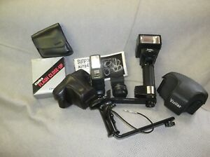 MISCELLANEOUS 35MM CAMERA EQUIPMENT LOT FLASHES CASES ETC