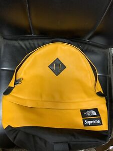 PRE-OWNED FW17 SUPREME x NORTH FACE LEATHER DAY PACK YELLOW Authentic Backpack