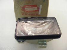 optique de phare  SUZUKI RG 80  1985-91  piece origine neuve ref:35121-46A40