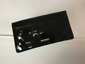 Jil Sander lacquer black clutch Logo