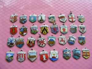 1bb) VARIOUS VINTAGE STERLING SILVER CHARMS UK & EUROPE TRAVEL SHIELD