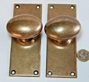 PAIR ANTIQUE EDWARDIAN BRONZE KNOB DOOR HANDLES WITH RECTANGULAR BACKPLATES