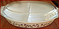 This Pyrex  1 1/2 qt. casserole dish is light yellow with bronze metallic patter