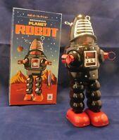 Robot mécanique en tôle. PLANET ROBOT modèle noir; ROBBY de Planète interdite.