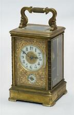 Brass Carriage Clock Enameled dials surrounded by raised floral deco. Lot 1292