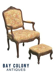19TH C ANTIQUE WALNUT FRENCH PROVINCIAL ARM CHAIR & FOOTSTOOL WITH FLORAL FABRIC