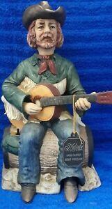 Vintage Waco Melody In Motion Porcelain Cowboy w/Guitar On Barrel Home On Range