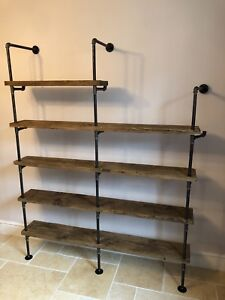 Industrial iron gas pipe and scaffold board shelving unit.