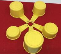 VINTAGE TUPPERWARE 5 PIECE MEASURING CUP SET BRIGHT YELLOW