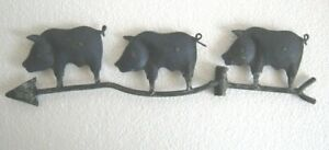 Iron three pigs weather vane .
