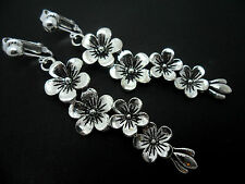 A PAIR OF LONG DANGLY TIBETAN SILVER FLOWER CLIP ON  EARRINGS. NEW.