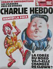AFFICHE PUBLICITAIRE CHARLIE HEBDO CARICATURE RONALD Mac DONALD et KIM JONG UN